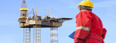engineer-looks-at-oil-rig-400x150